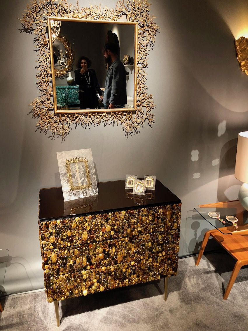 The cabinet is truly a jewel-encrusted work of art.