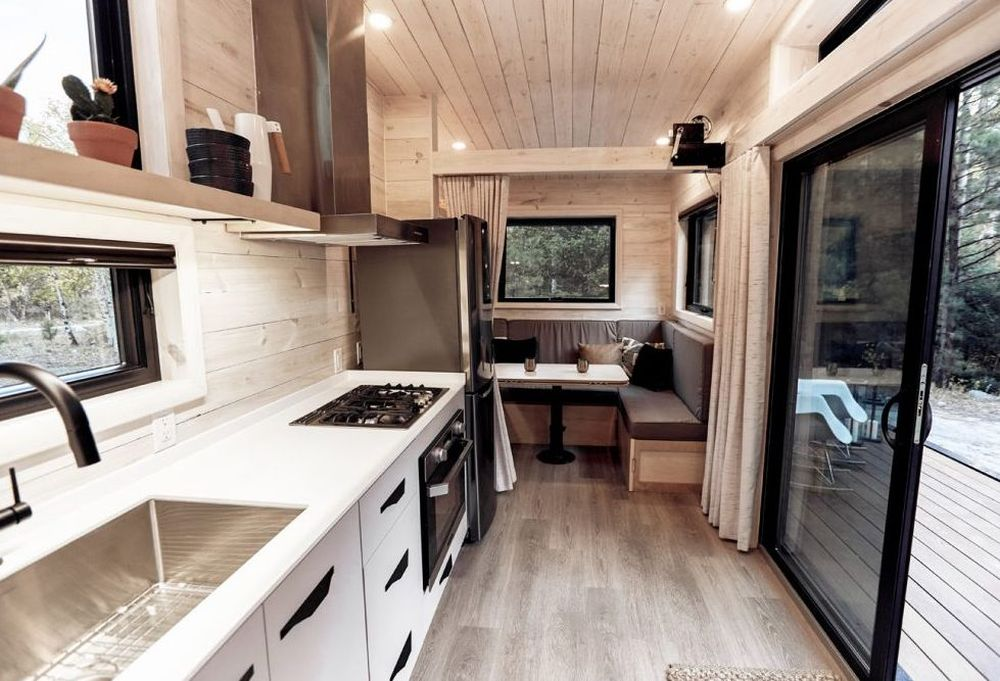 The kitchen is surprisingly well equipped and spacious, featuring a cozy seating nook at one end