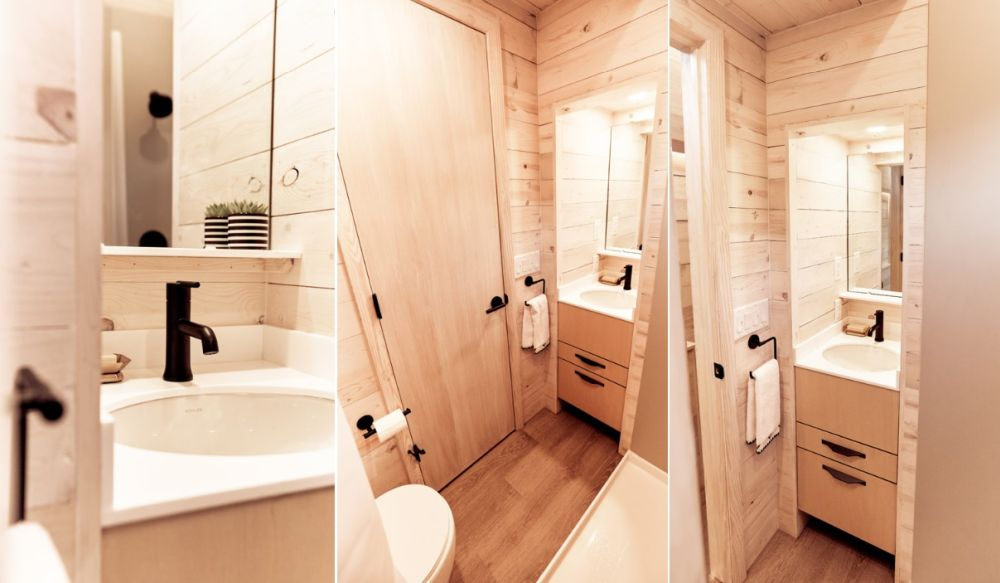 The tiny bathroom also has a wink and a wall-mounted mirror built into a nook on one side of the door