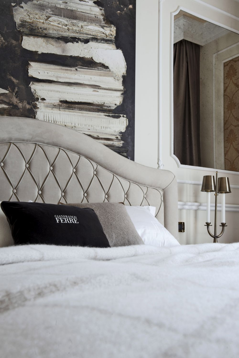The Ferre brand label can be seen on the pillows.