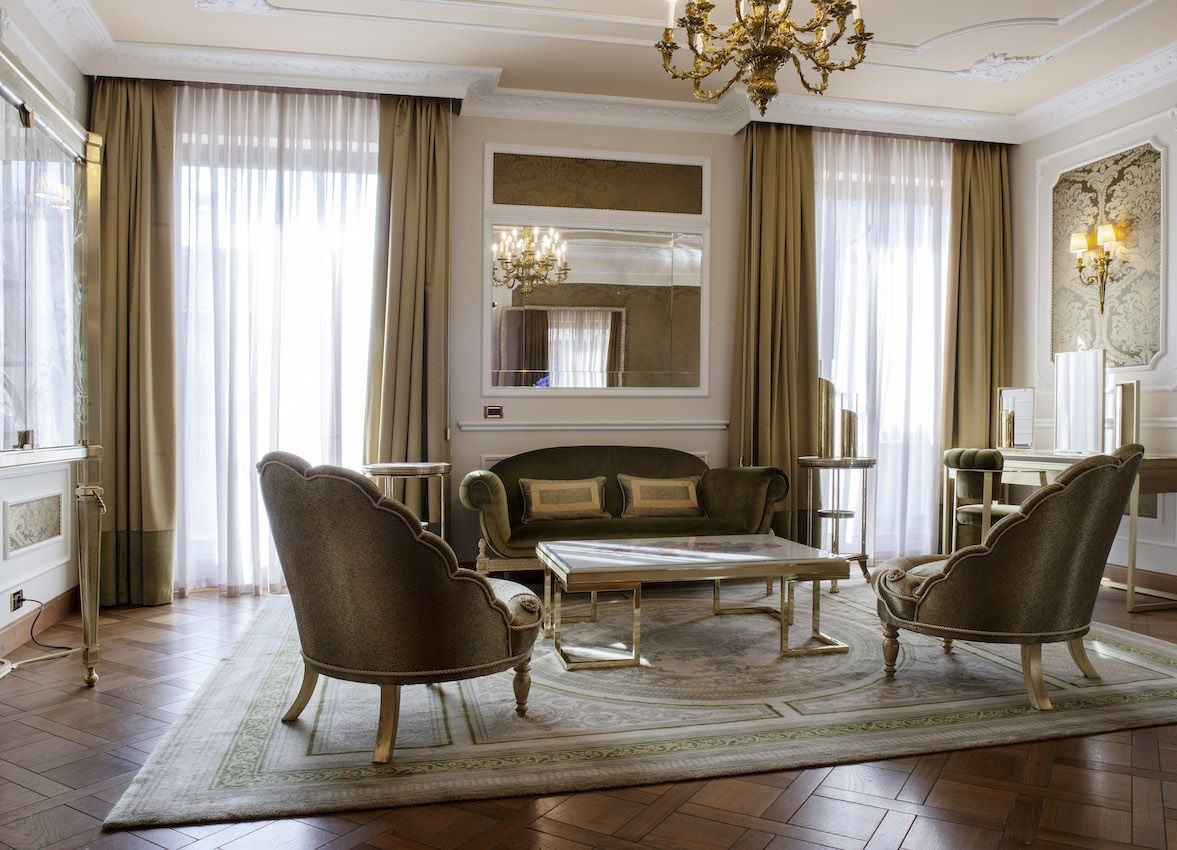 A magnificent sitting room is with opulent furniture is part of the suite.