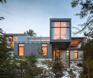 A House Perched On A Steep Slope Captures The Beauty Of The Rivière