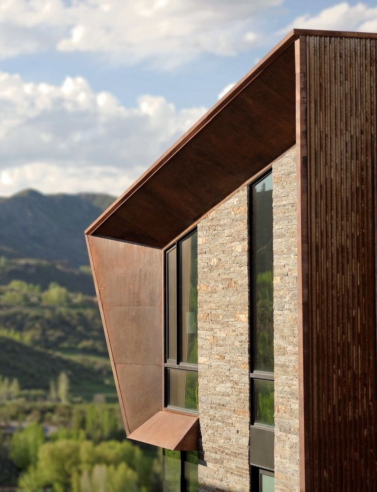 The exterior of the residence has a corten steel frame which allows it to easily blend into the landscape