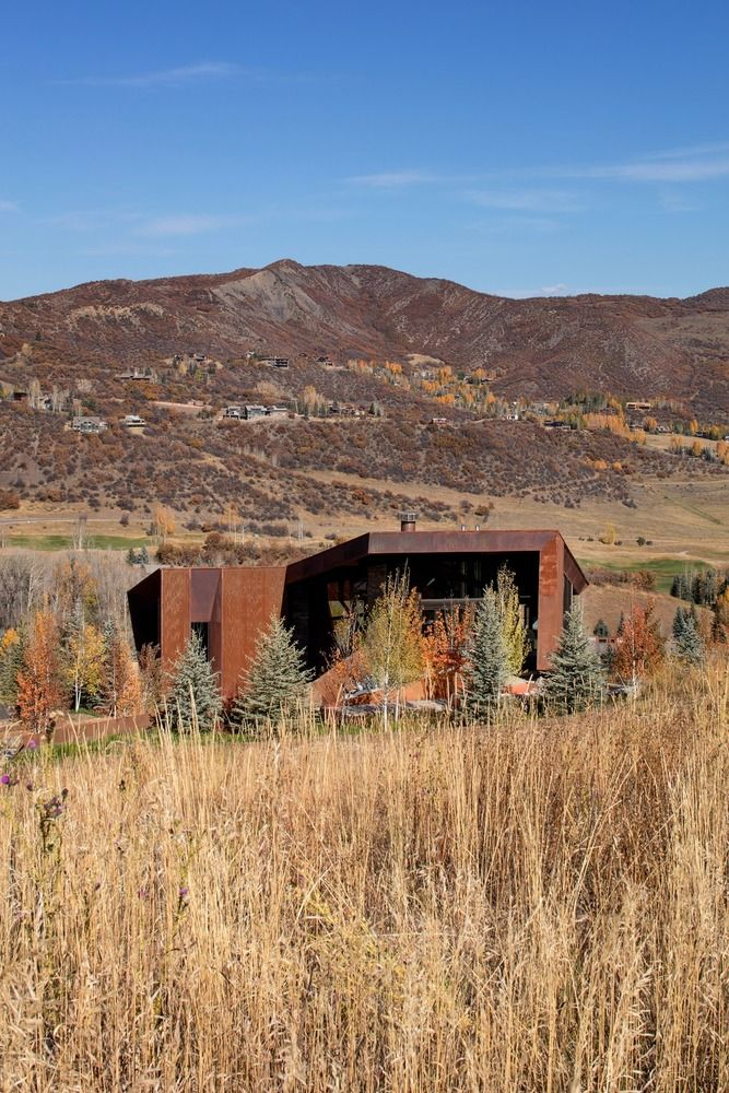 The corten facade ages with time and becomes more and more embedded into the landscape