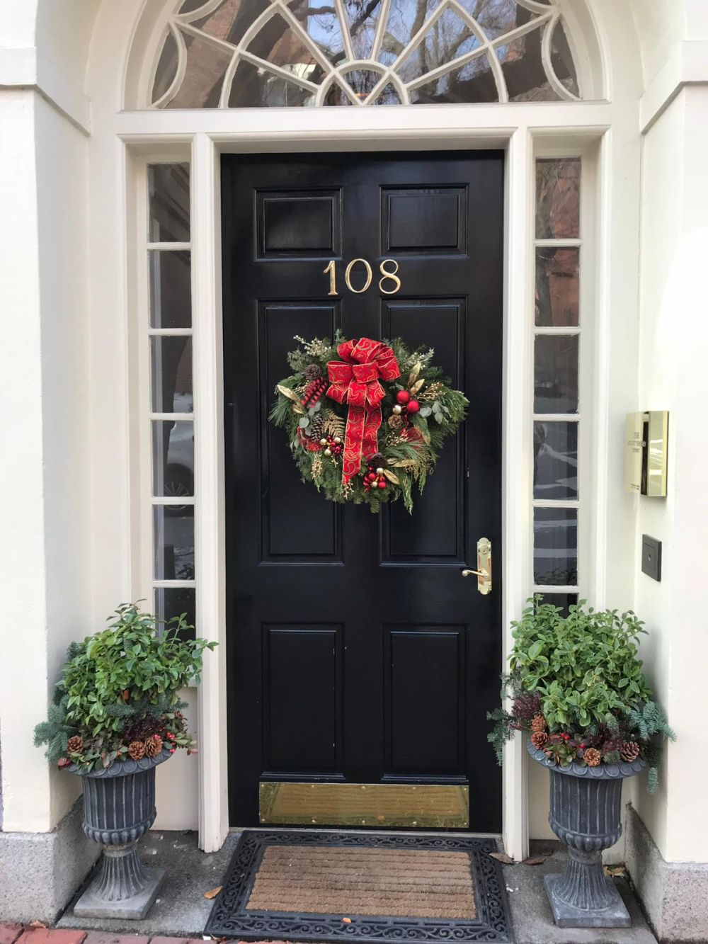 The wreath can come as a seasonal addition to your existing front door decor