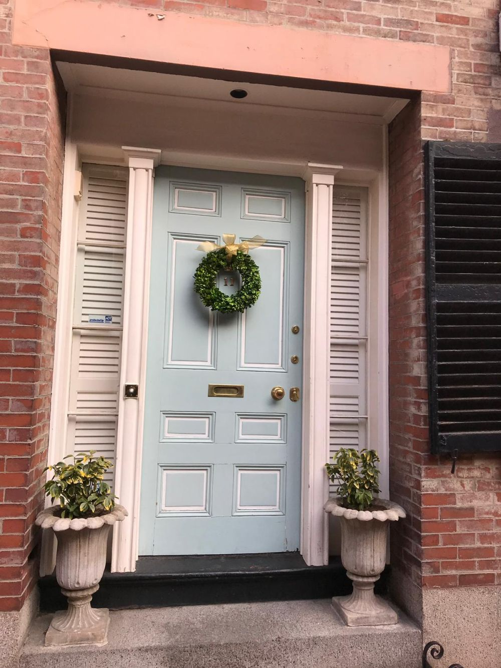 Position the wreath so it frames. your house number for a chic, elegant touch