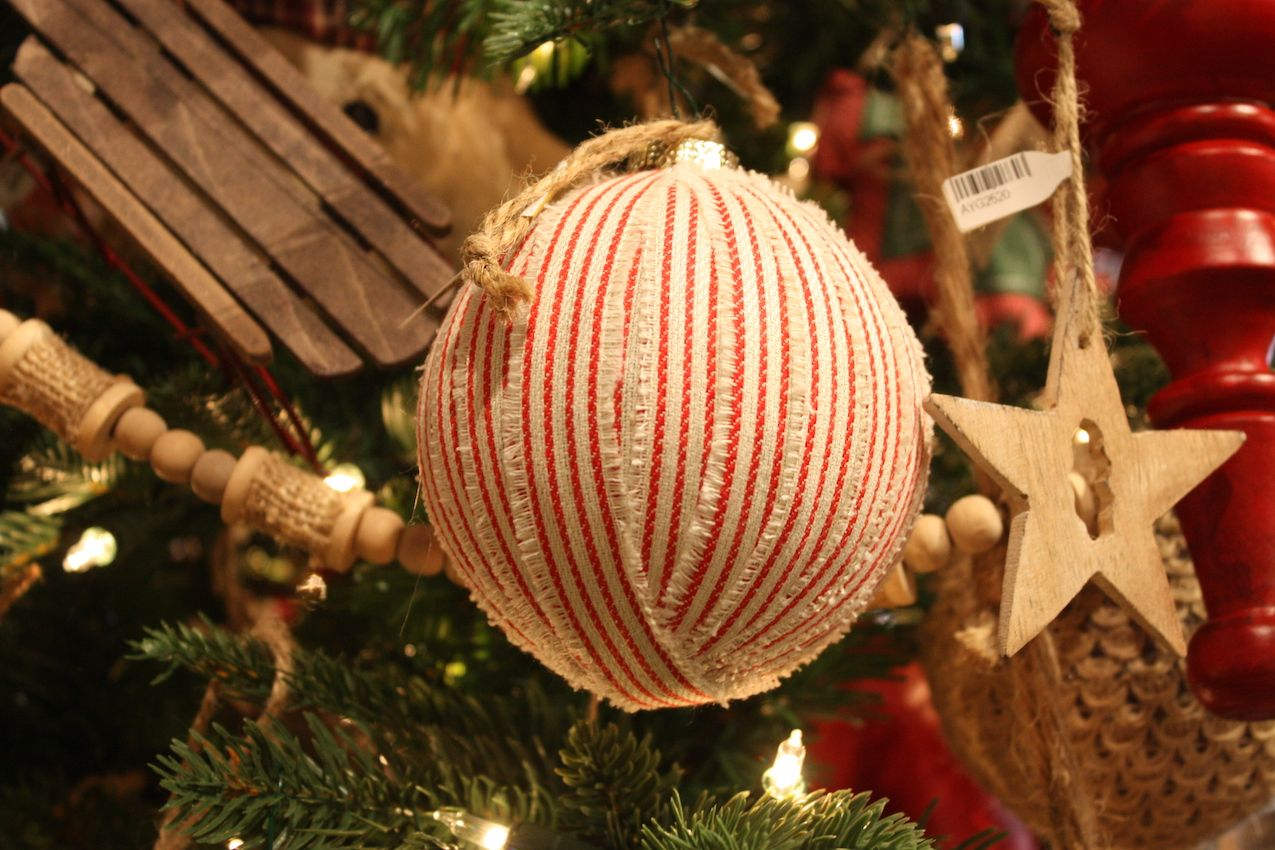 A natural fabric and frayed edges lend this ribbon-covered ball a homey look.