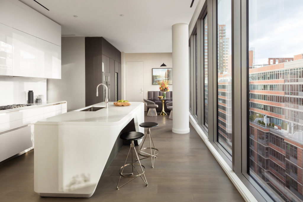 A neutral palette and sleek cabinetry are good choices for an urban kitchen.