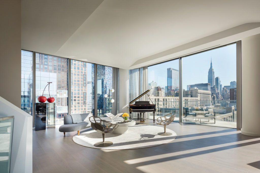 Floor-to-ceiling corner windows offer spectacular views.