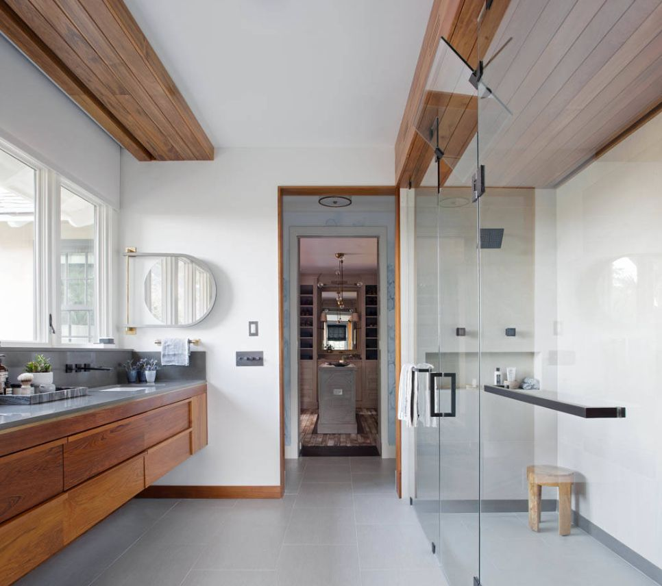 Big windows along the bathroom vanity let in a great deal of natural light.