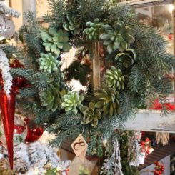 Combining traditional greenery with an unusual type of plant creates a distinctive wreath.