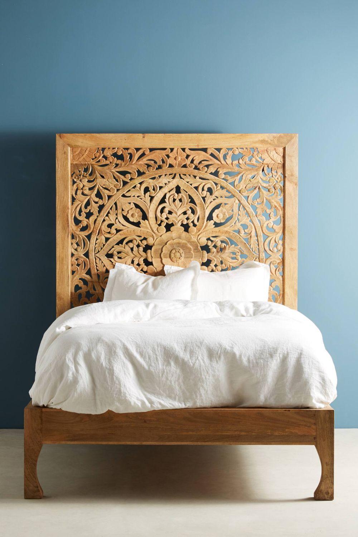 Boho bedroom with carved headboard