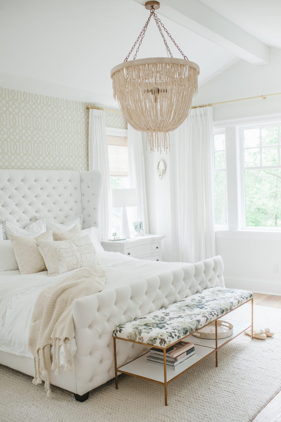 Decorating a bedroom with white tufted bed