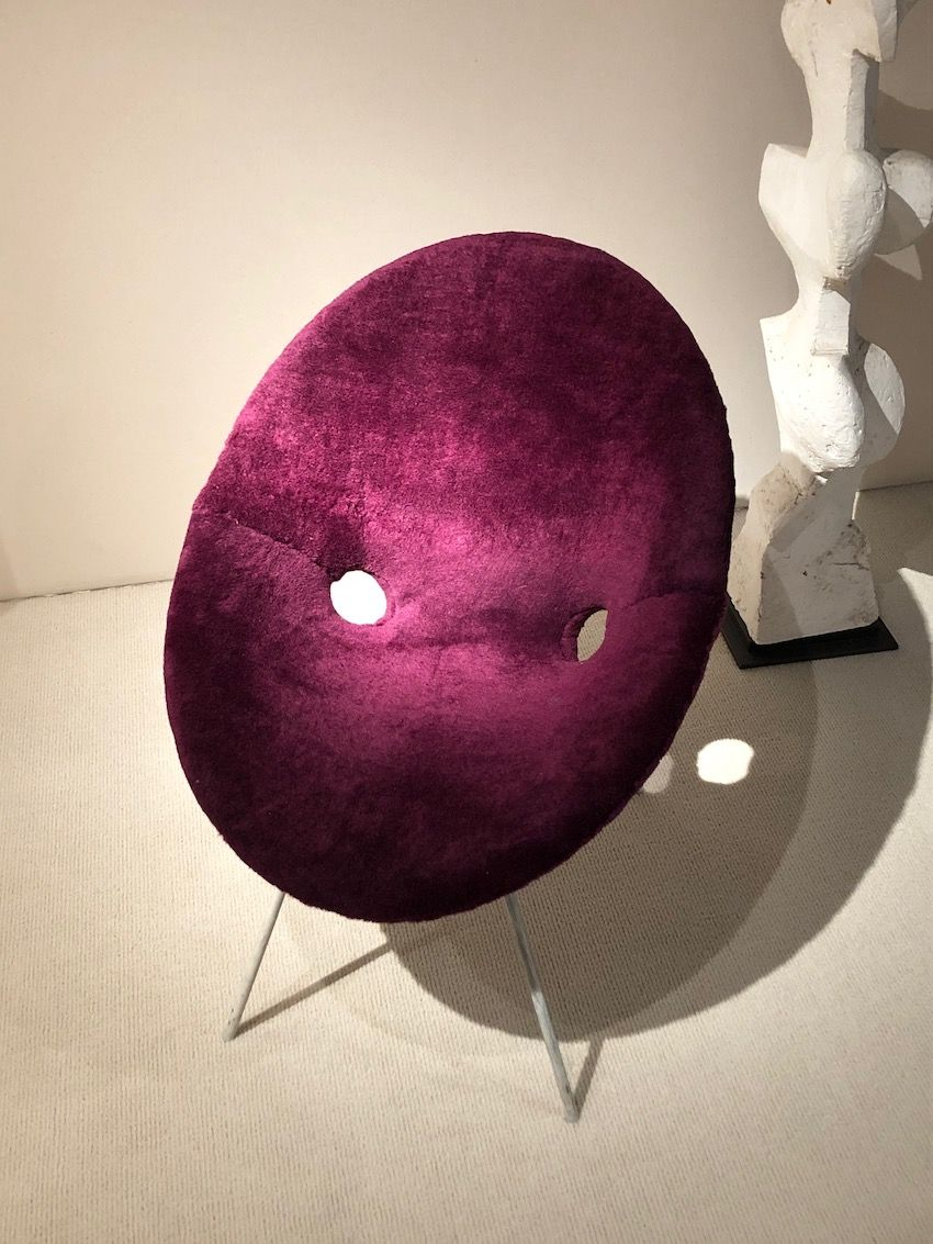 The shape and color of this Eddie Harlis chair add to its fun nature.
