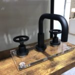 Newport Brass industrial style faucet and handles have the very popular matte black finish.