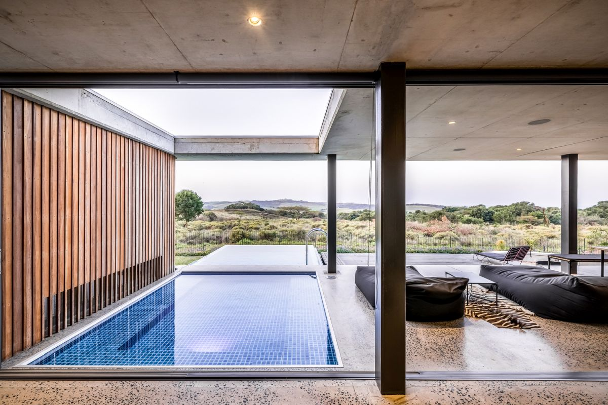 The indoor-outdoor swimming pool is the strongest link between the house and its immediate surroundings