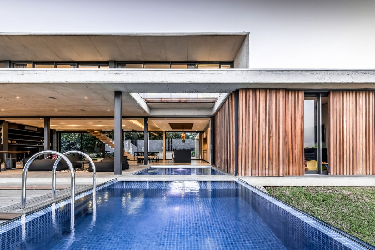 The swimming pool literally brings the outdoors in in tandem with cool reflections of the sky