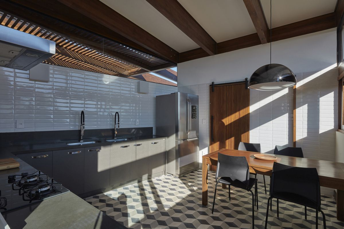 A large kitchen spread along two adjacent walls, framing the dining area