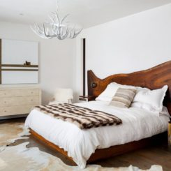 Beautiful bedroom featuring a wood live edge headboard