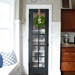 Black pantry door with glass windows