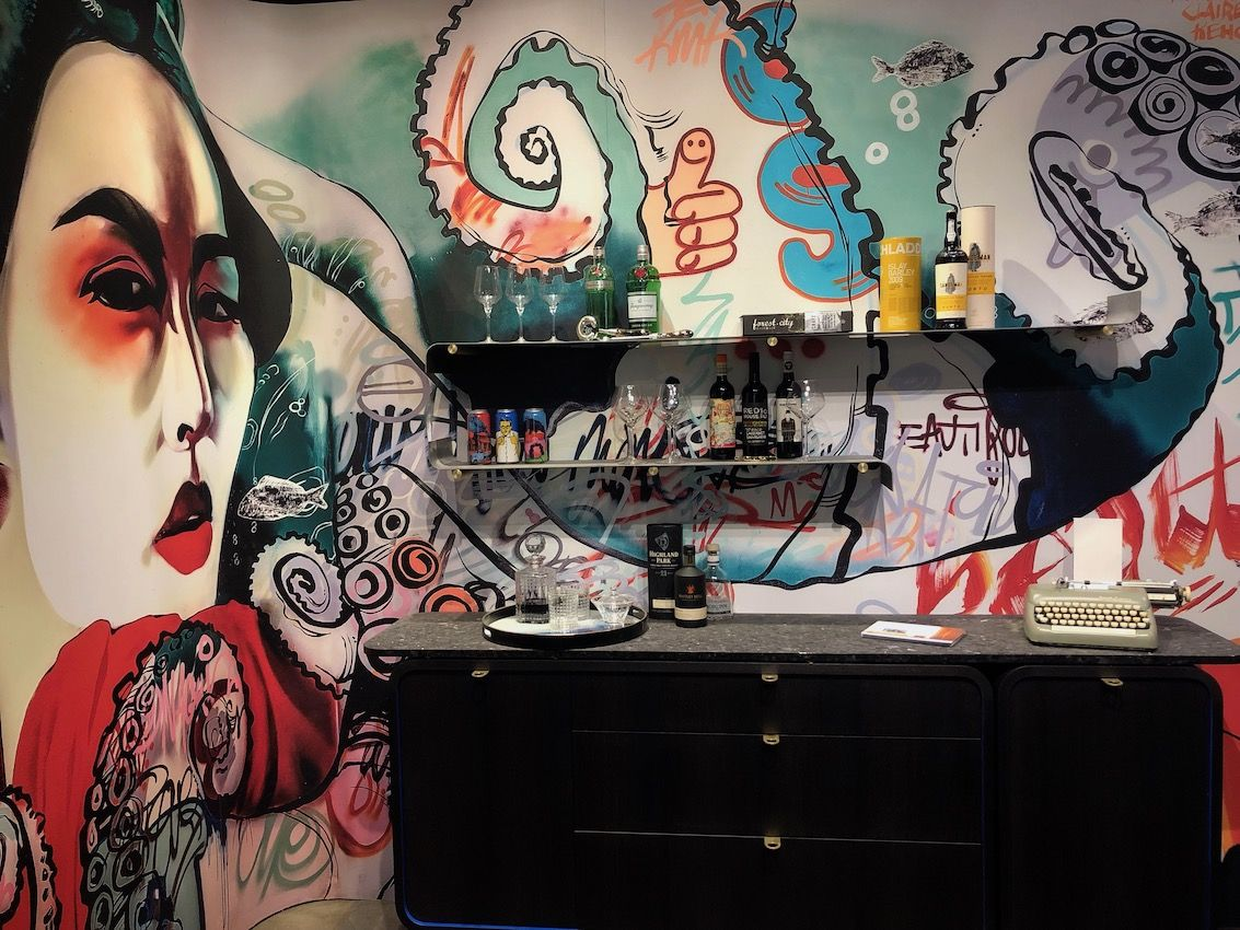 A retro cabinet works perfectly with the bold mural.