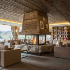 Chalet style living room large fireplace in the middle
