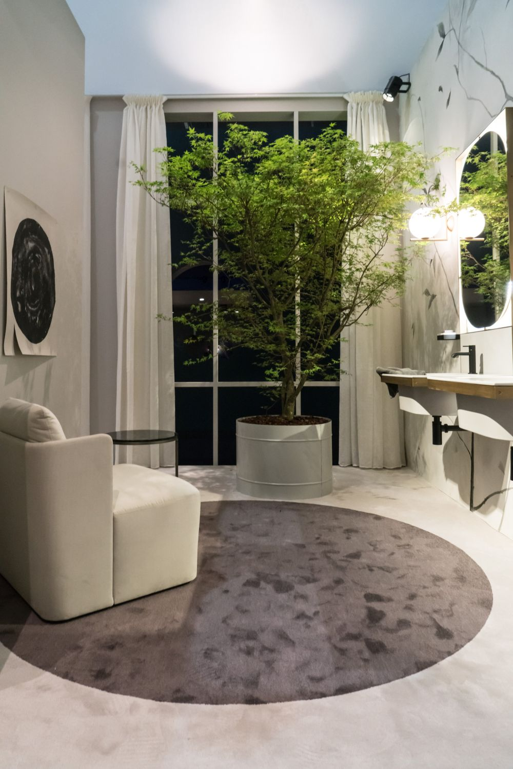 This bathroom space has a vanity and feels like a living room.