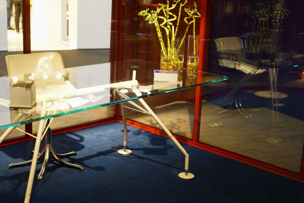 A glass desk is a chic office furniture idea.