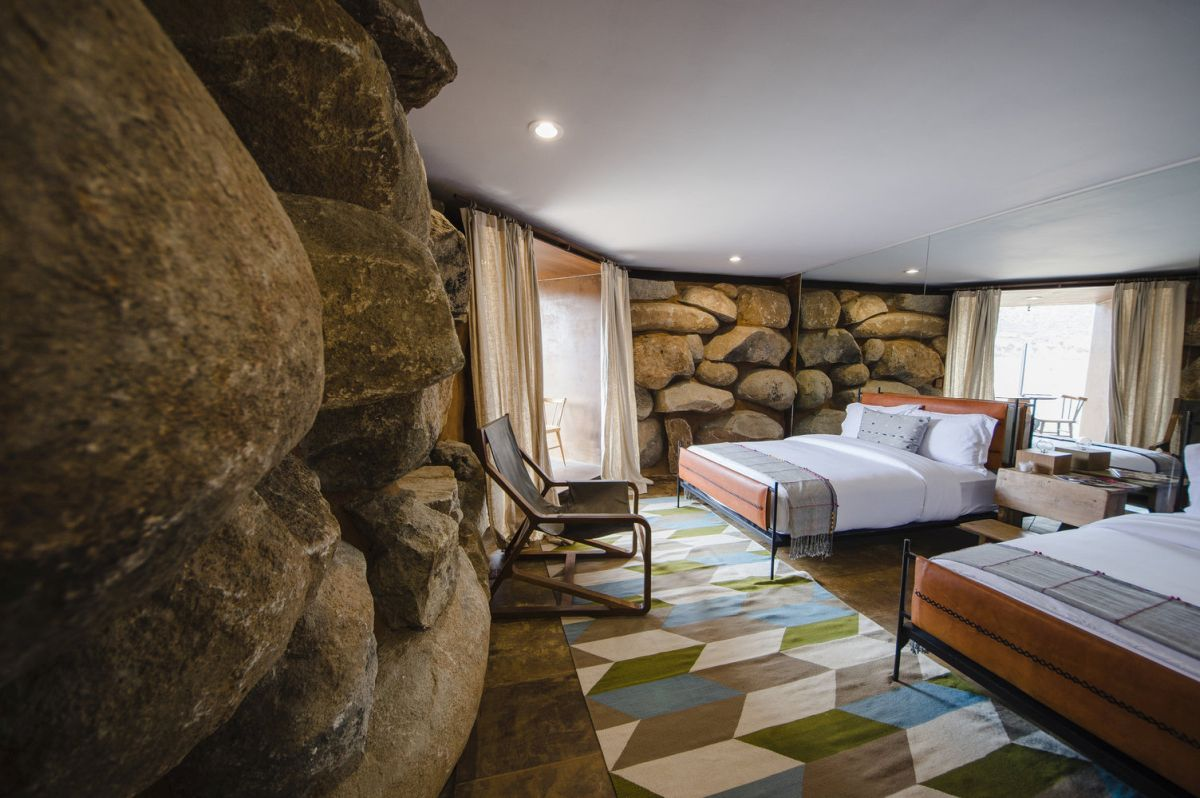 The interior spaces have walls of rocks, as if the landscape takes over the design