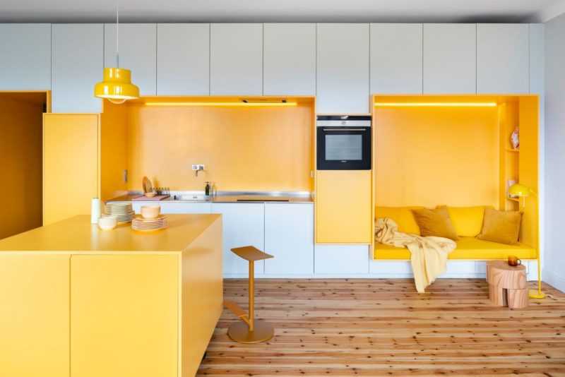 1920's Apartment Rejuvenated With Warm Shades Of Yellow