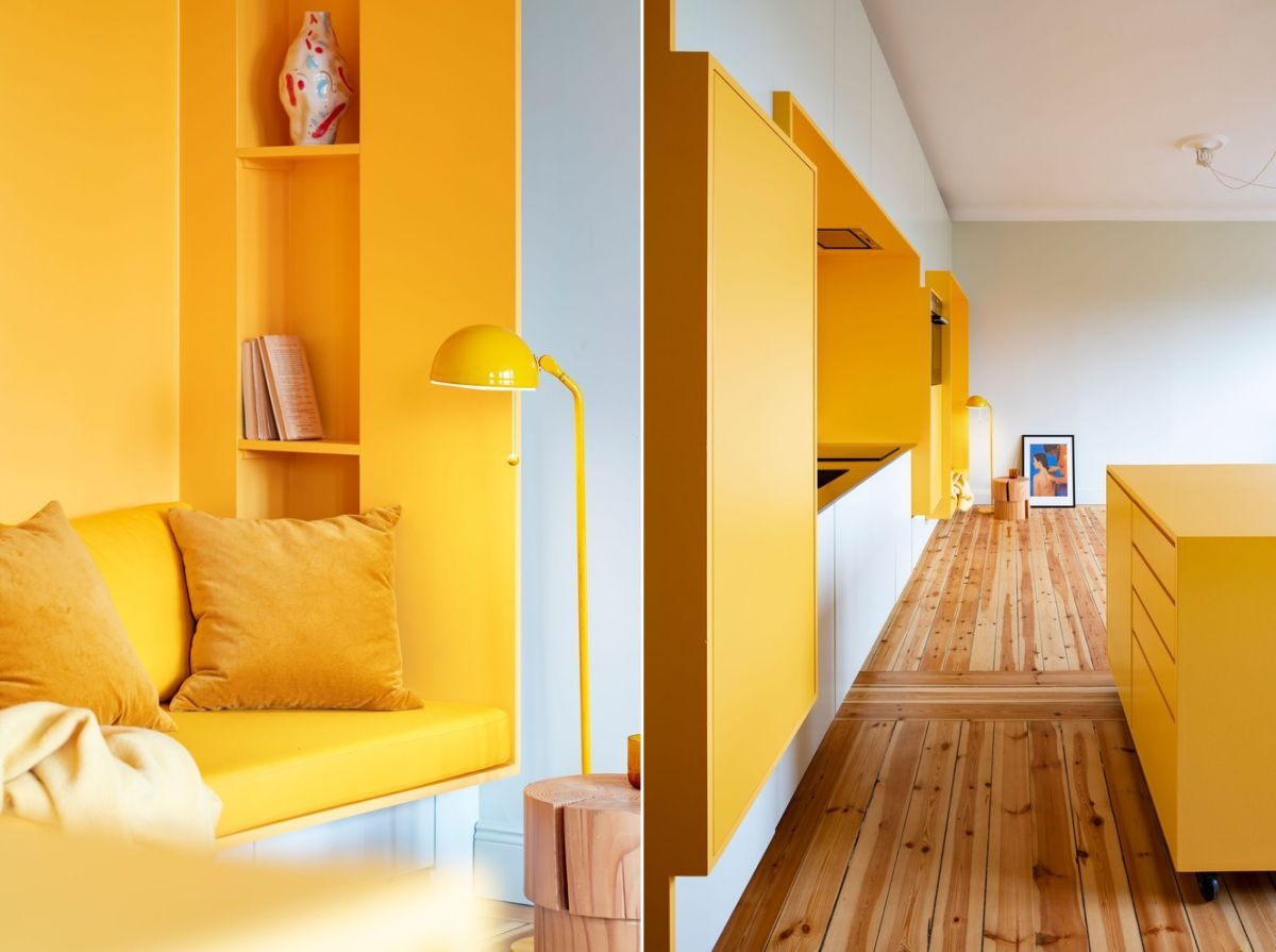 The warm yellow tones contrast with the crisp white ceilings faint grey walls and wood
