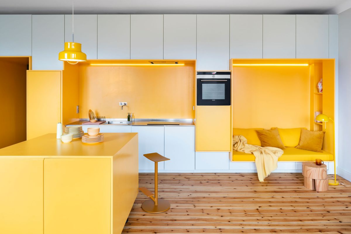 1920s apartment rejuvenated with warm shades of yellow