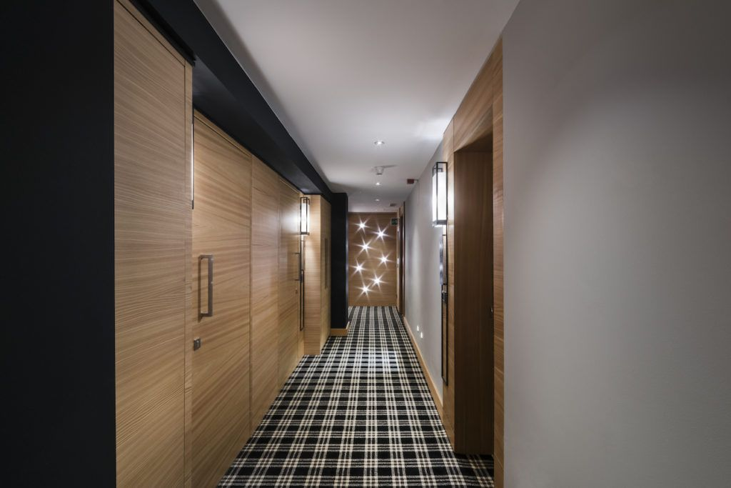 A black and white graphic hallway carpet is a modern addition.