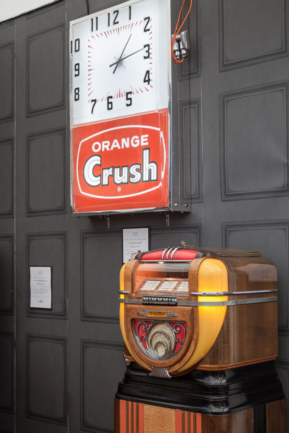 Old-fashioned signs and pieces like jukeboxes work well in a man cave.