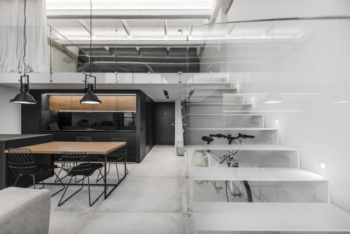 The staircase has minimal impact on the loft's interior design and overall look and ambiance