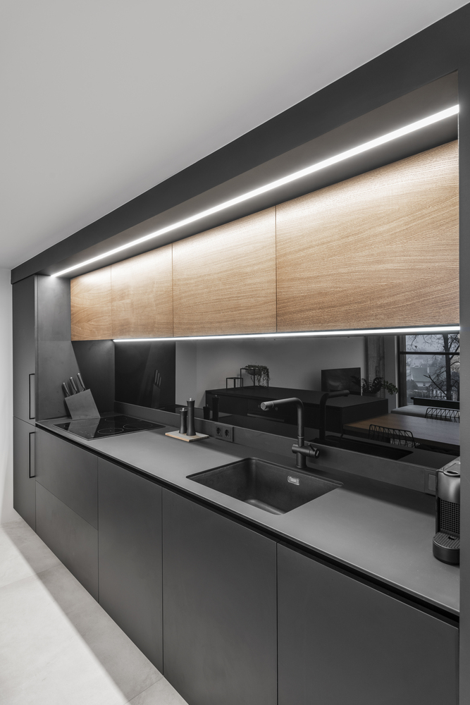 LED light strips and mirrored surfaces play an important role throughout the apartment's interior design