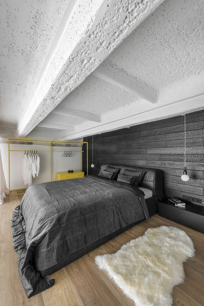 The upstairs bedroom features a yellow metal wardrobe which brightens up the space with its cheerful color