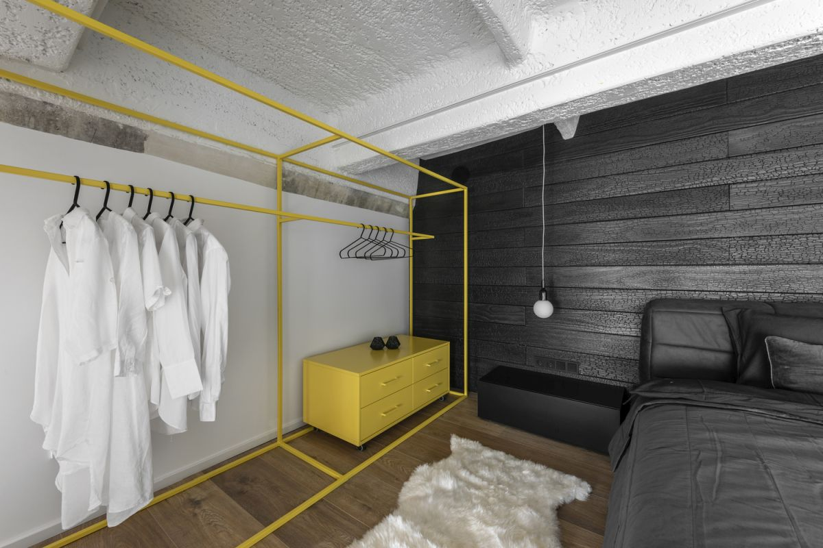 The bedroom wardrobe is open and adds a graphical twist to the decor