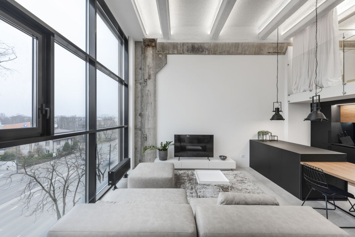 The walls and ceiling have been painted white and the columns were left exposed for a balanced aesthetic