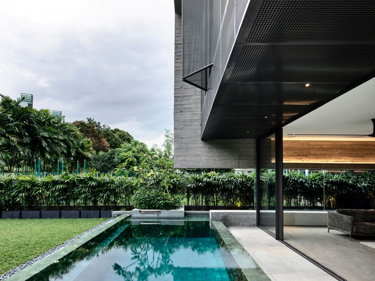The pool runs parallel to the house as if it's a natural part of its design and structure