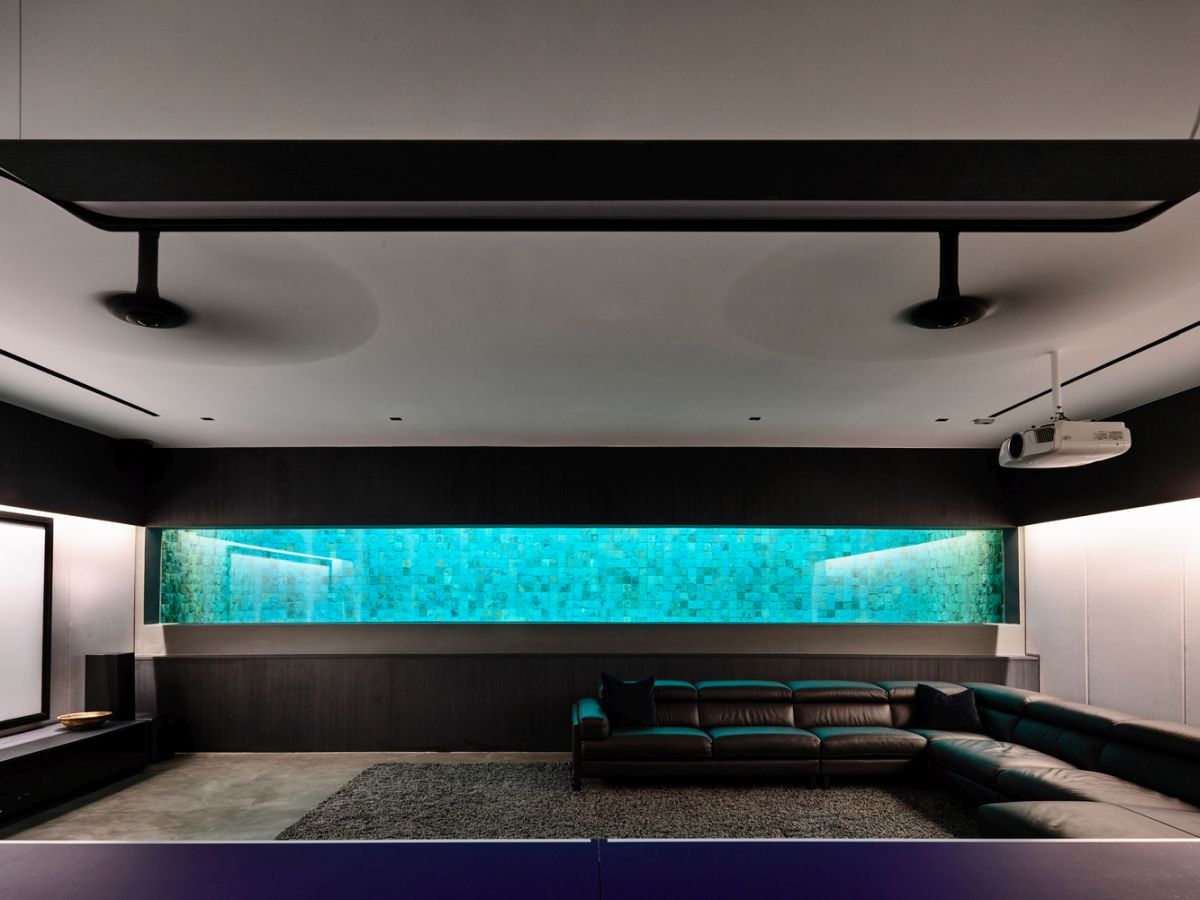 The basement area has this cool glass panel which connects it to the pool and lets in light and color