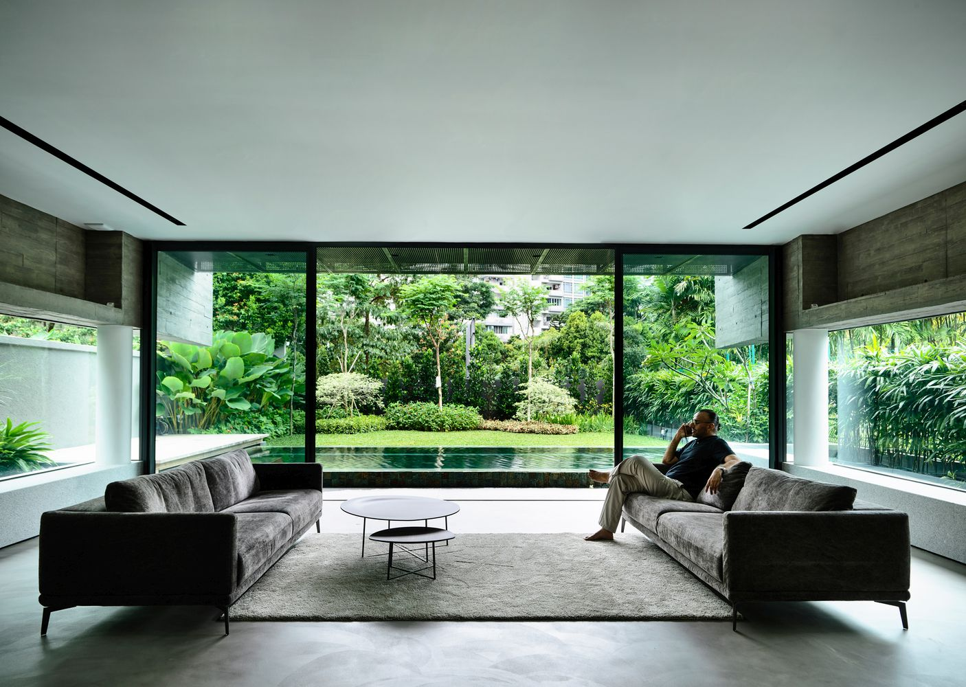 The ground floor living area has gorgeous views of the pool and the garden beyond it