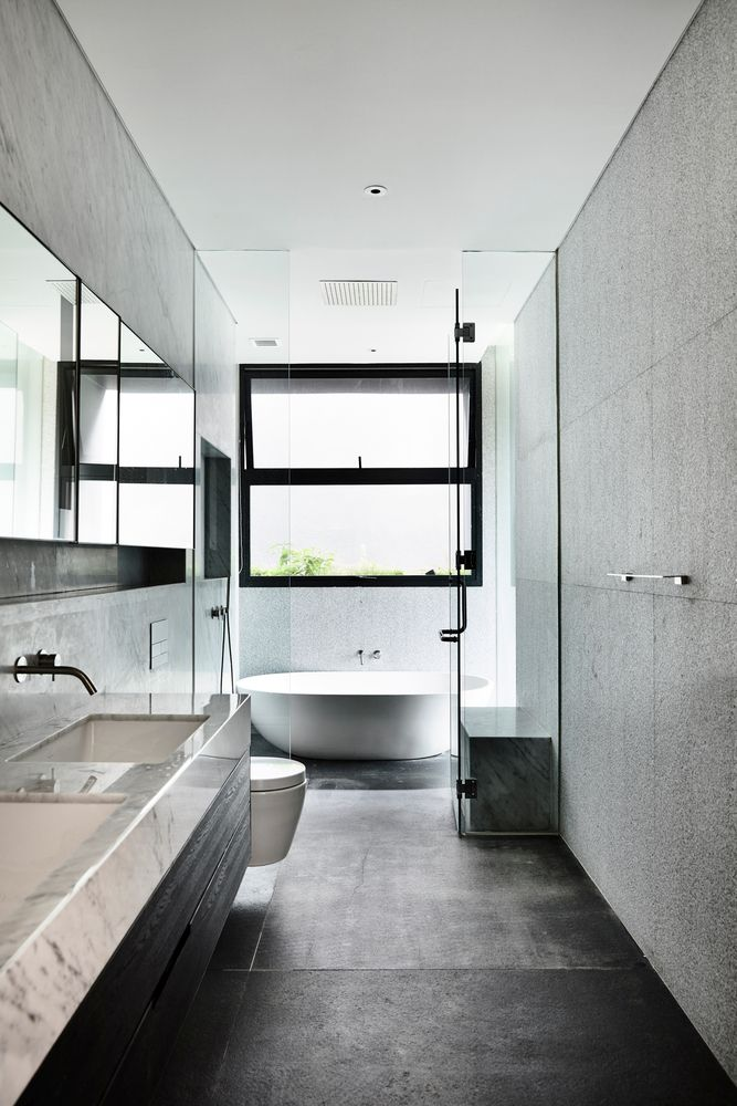 Concrete surfaces and gray finishes are common throughout the house