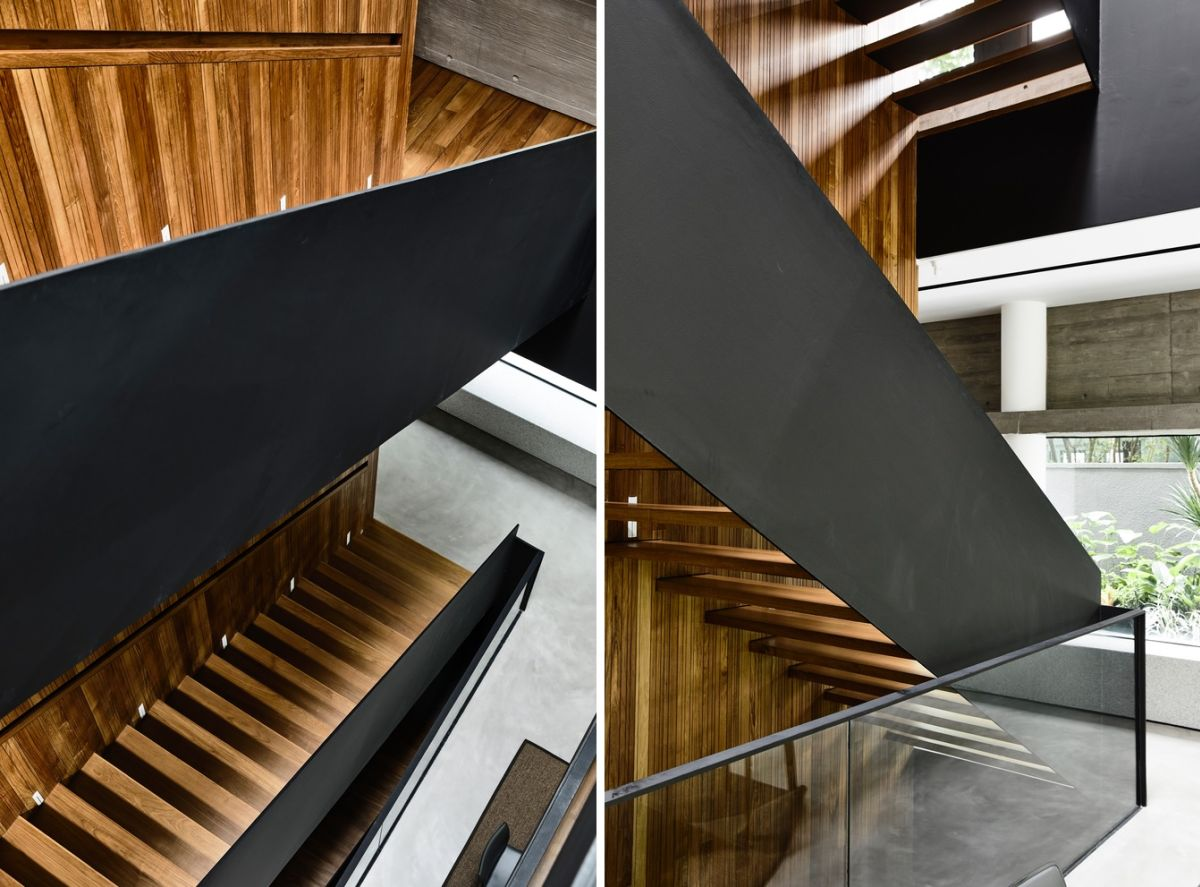 The staircase connecting the four floors is an elegant mix of black steel, teak wood and glass