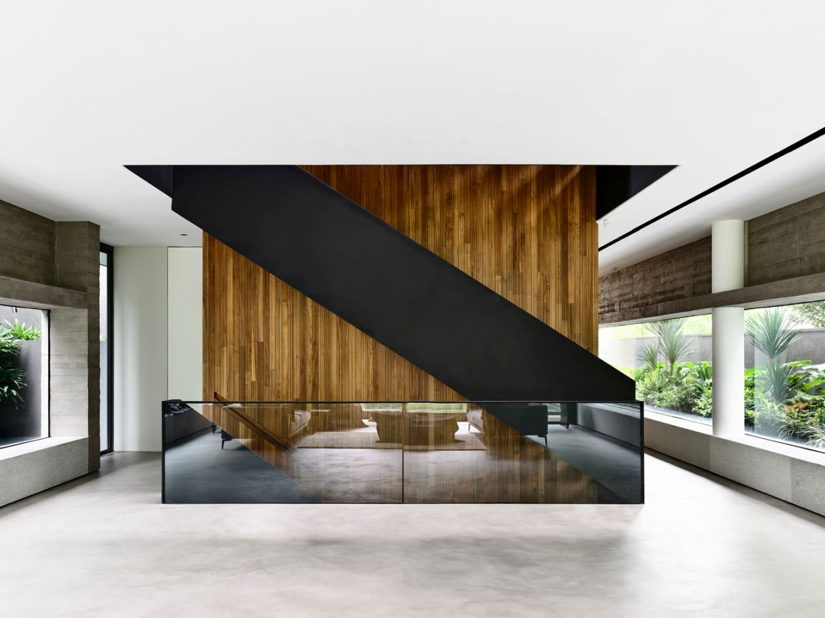 the house has four floors and includes an attic and a basement area, all connected via a black steel staircase