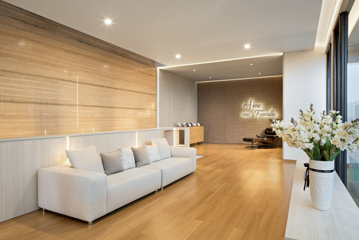 The ground floor contains all the common spaces and socializing areas, including this simplistic living room