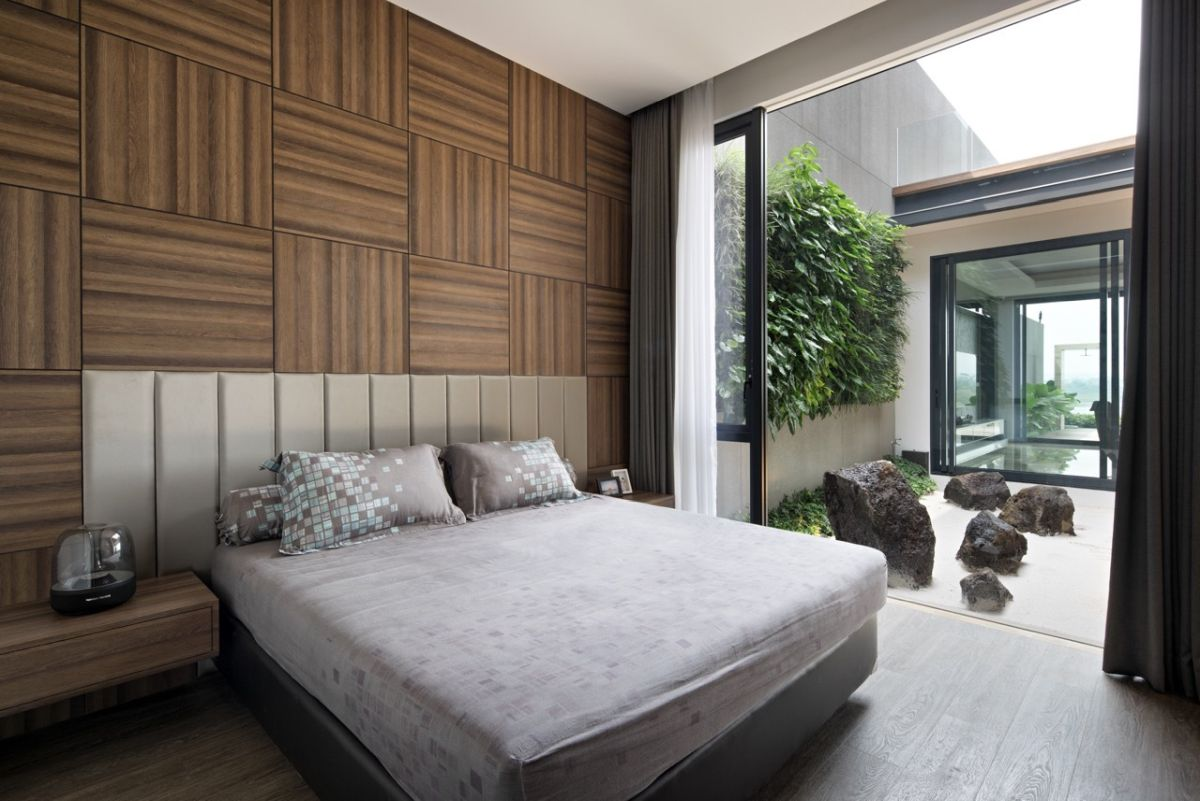 The master bedroom has a very stylish accent wall which brings warmth and pattern to the decor