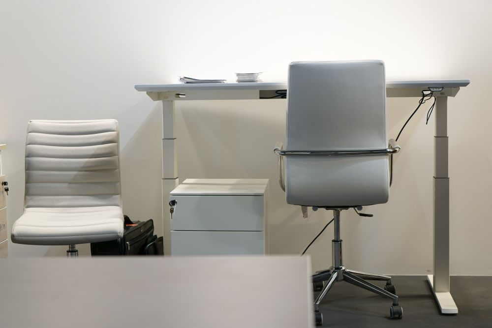 Adjustable desks allow for sitting or standing.