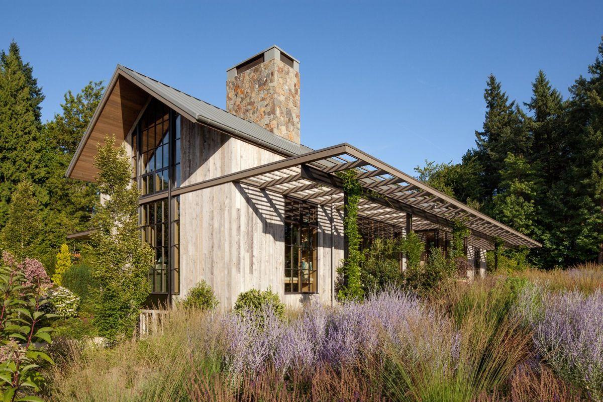 Expertly designed gardens enhance the house.