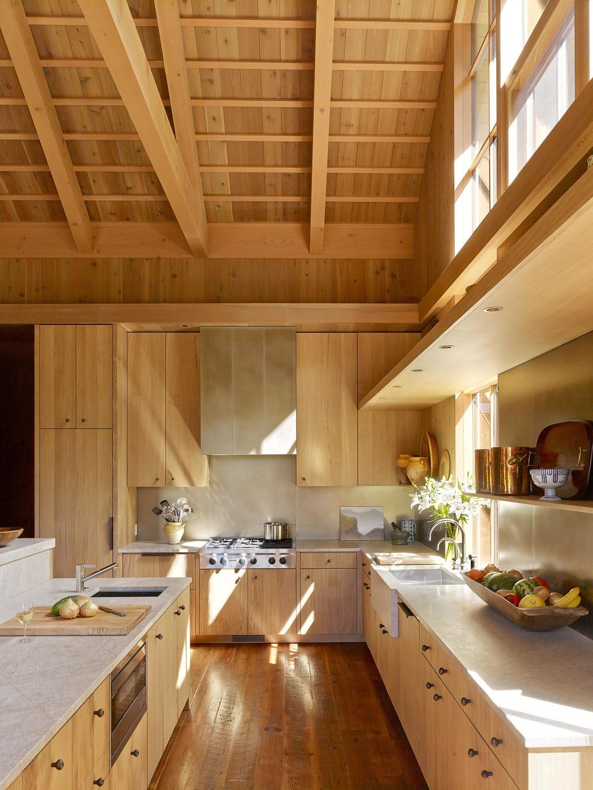 The kitchen maintains the rustic, natural feeling.